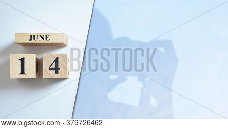 June 14, Shadow Of Photographer With Number Cube.