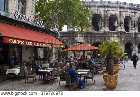 Nimes / France / May 1 2011 : People Take Lunch At An Elegant Pavement Cafe In The Old Town Of The H