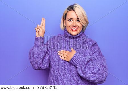 Beautiful blonde plus size woman wearing casual turtleneck sweater over purple background smiling swearing with hand on chest and fingers up, making a loyalty promise oath