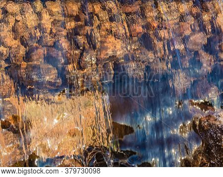 Blurred Image Formed By A Falling Wall Of Water. A Variety Of Water Figures In The Waterfall. Transl