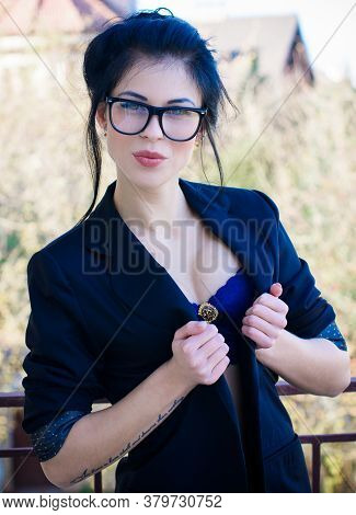 Image Of A Sexy Business Woman In A Bra And A Jacket With Glasses. The Concept Of Eroticism In Every