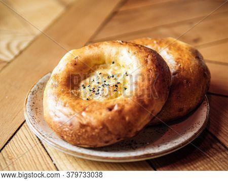 Tasty Fresh Tandoor Bread On Rustic Wooden Tabletop. Two Tandoor Flat Bread Cake With Black Sesame S