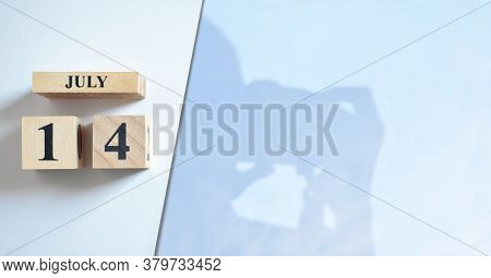 July 14, Shadow Of Photographer With Number Cube.