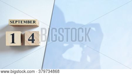 September 14, Shadow Of Photographer With Number Cube.