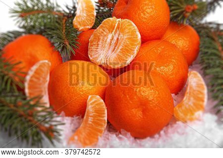 Tangerines In The Snow. The Symbol Of Winter Holidays Is The Fruit Of The Tangerine Tree.