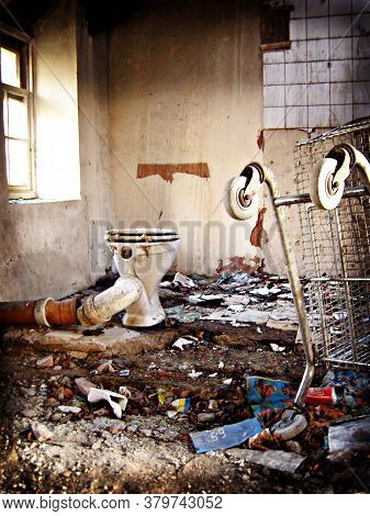 Derelict House Loo With Additional Rubbish Including A Shopping Trolley