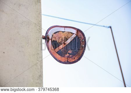 Old Rusty Curved Road Sign: Not Allowed Road On The Wall. Traffic Sign