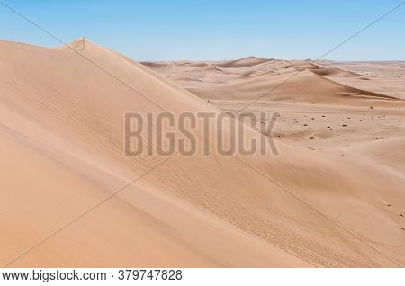 A Person Is Visible On Dune 7 At Walvis Bay On The Atlantic Ocean Coast Of Namibia