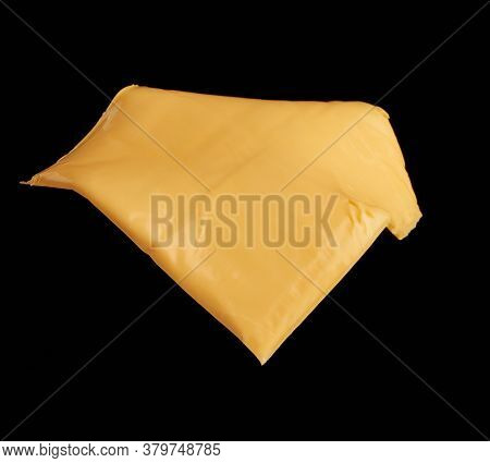 Square Piece Of Cheddar Cheese Isolated On Black Background, Ingredients For Sandwich, Close Up
