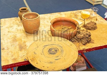 Clay Pottery Wheel And Tools At Table