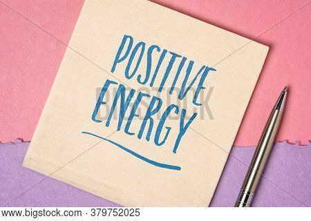 positive energy inspirational note - handwriting on a napkin against handmade paper, mindset and presersonal development concept
