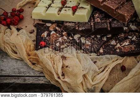 Black, White, Milk Chocolate Pieces. Many Types Of Chocolate