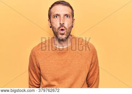 Young handsome man wearing casual clothes scared and amazed with open mouth for surprise, disbelief face