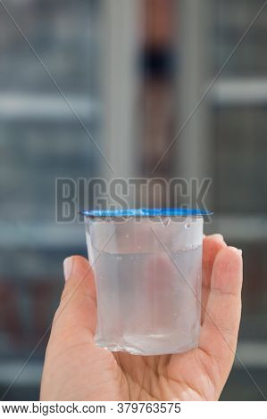 Disposable Turkish Eco Glass Of Clean Water In A Plastic Bag. Convenient Environmental Capacity For