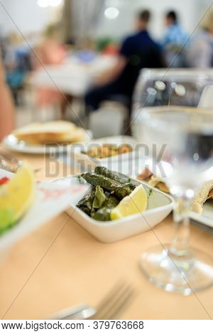 Traditional Turkish Dish Yaprak Sarm - Rice In Grape Leaves. Serving In A Turkish Restaurant