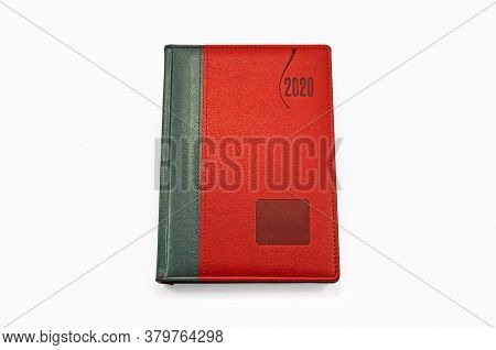 Red Personal Business Organizer For 2020 On A White Background. Isolated View From Above