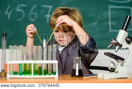 Small Boy At Science Camp. Microscope At Lab. Scientific Experiment. Pupil Looking Through Microscop