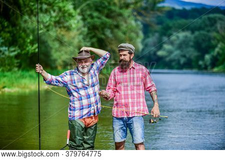 Male Friendship. Family Bonding. Father And Son Fishing. Hobby And Sport Activity. Trout Bait. Two H