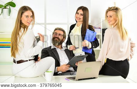 So Busy. Explain Ideas At Workplace. Business Colleagues In Modern Office. Boss Is Surrounded By Ass