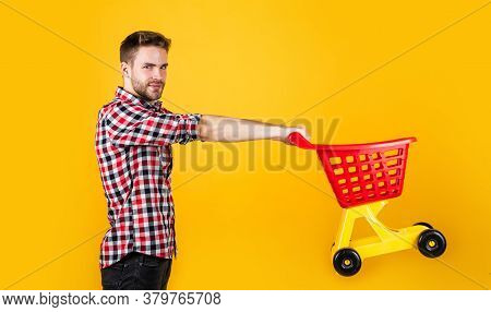 Customer Pushing Cart. Buyer In Supermarket. Empty Toy Trolley. Man Go Shopping. Funny Man With Smal