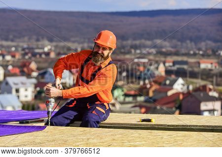 Picky Inspector. New Roof Under Construction Residential Building. Builder Use Drill. Professional M
