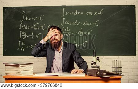 Fed Up. Man Desperate Teacher In Classroom. No Hope For Better. Tired And Exhausted. Teaching Dumb S
