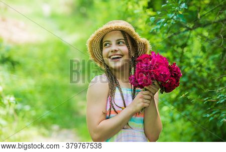Perfect Day. Beautiful Girl With Flowers. Little Girl Holding Pink Fresh Blossoming Flower Bouquet O