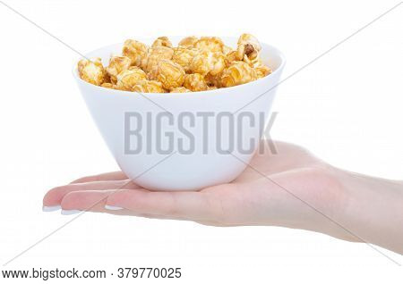 White Bowl With Caramel Sweet Popcorn In Hand On White Background Isolation