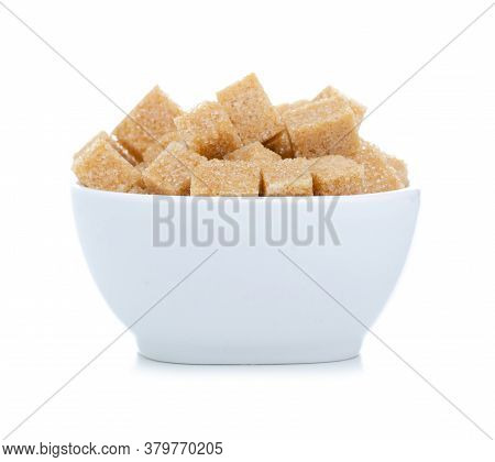 White Bowl With Cane Brown Sugar Cubes On White Background Isolation