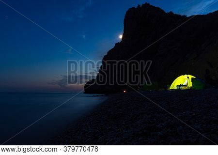 Tent On The Beach At Night. Full Moon Over The Mountain. Outdoor Recreation. Night Seascape. Traveli