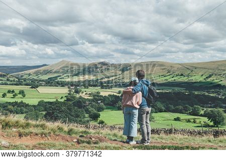 Father Is Hugging His Daughter And They Areobserving Beautiful Field View On Edale Village And Mam T
