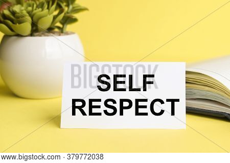 Self Respect. Text On White Paper On A Yellow Background Near The Diary And Flowerpot