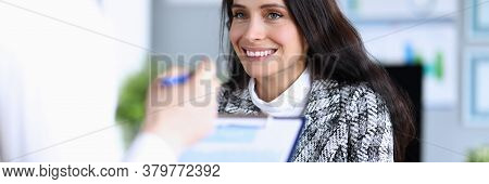 Smiling Woman In Suit Looks At Man In Office. Girl Rejoices That Her Work Is Appreciated. Research A