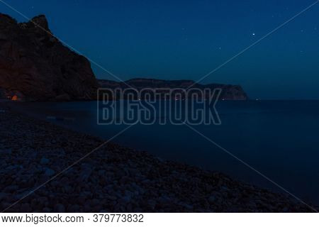 Night Seascape. Summer Vacation On The Shore Of The Night Sea. Stars In The Blue Sky Of Twilight. Be