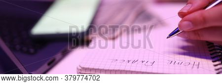 Close-up, Womans Hands Write Notepad Home Finances. Tensions In Personal Finance During Quarantine.