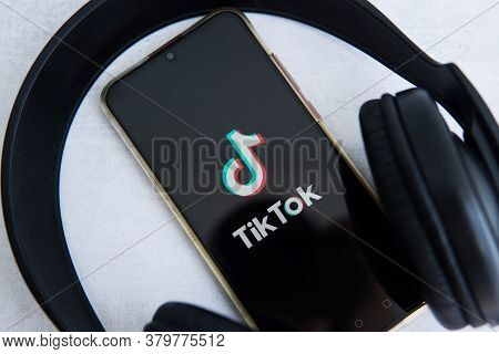 Tver, Russia-august 5, 2020, The Tik Tok Logo On The Smartphone Screen On Light Background With Larg