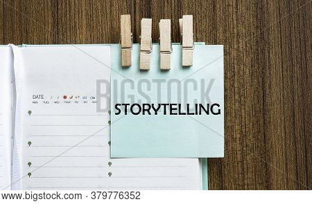 Storytelling Notes Paper And A Clothes Pegs On Wooden Background