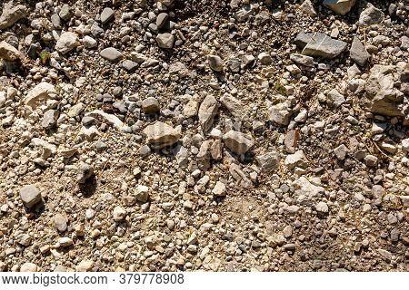 The Texture Of Stone Soil. Background Image Of A Stone Crumb With Small And Large Stones
