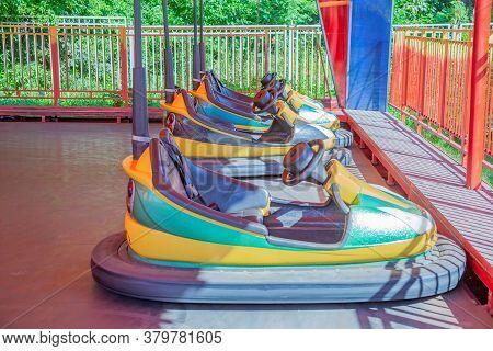 Small Cars At The Summer Amusement Park