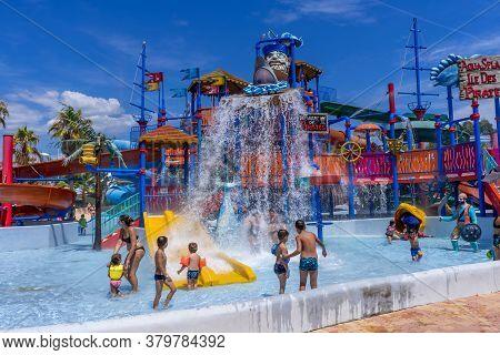 Antibes, France 26.07.2020 Water Park, Slides Near The Pool, Summer Holidays. Children Having Fun On