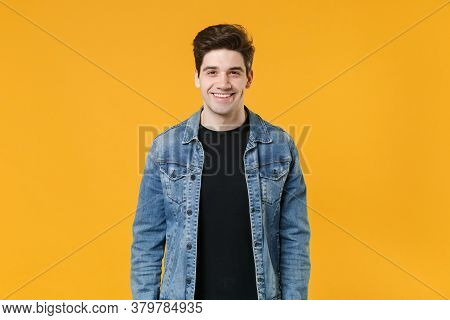 Smiling Handsome Young Man Guy Wearing Casual Denim Jacket Posing Isolated On Yellow Wall Background