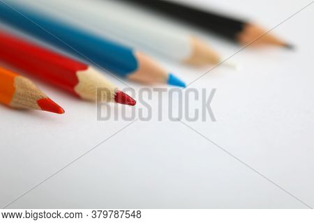 Close-up Of Pencils Laying On Blank Paper, Multicolor Pens For Drawing. School Or Office Supplies Fo
