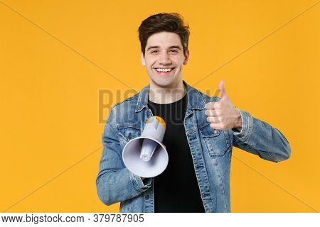 Smiling Young Man Guy 20s In Casual Denim Jacket Posing Isolated On Yellow Background Studio Portrai