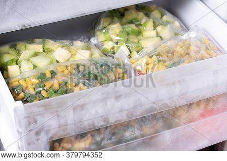 Assortment Of Frozen Vegetables In Home Fridge. Frozen Food In The Freezer