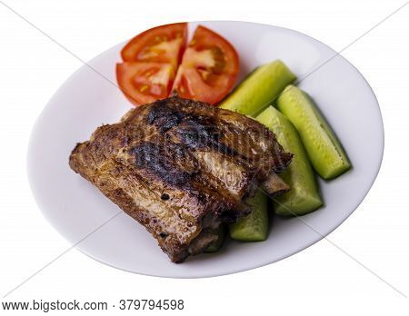 Grilled Pork Ribs With Sliced Cucumbers And Tomatoes On White Plate. Pork Ribs Isolated On White Bac