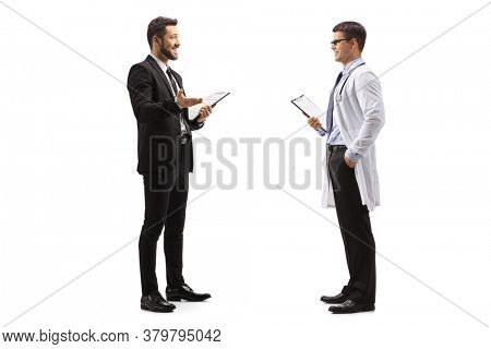 Full length profile shot of businessman talking to a male doctor isolated on white background