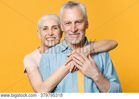 Smiling Elderly Gray-haired Couple Woman Man In Casual Clothes Posing Isolated On Yellow Background