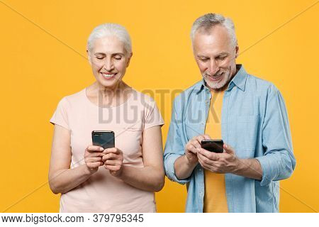 Smiling Elderly Gray-haired Couple Woman Man In Casual Clothes Isolated On Yellow Wall Background St