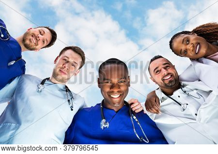 Medical Team Huddle And Staff Group Unity