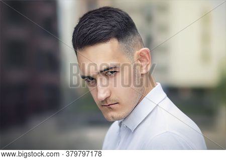 Close Up Portrait Of Serious Upset Handsome Man, Young Sad Frustrated Offended Guy Looking At Camera